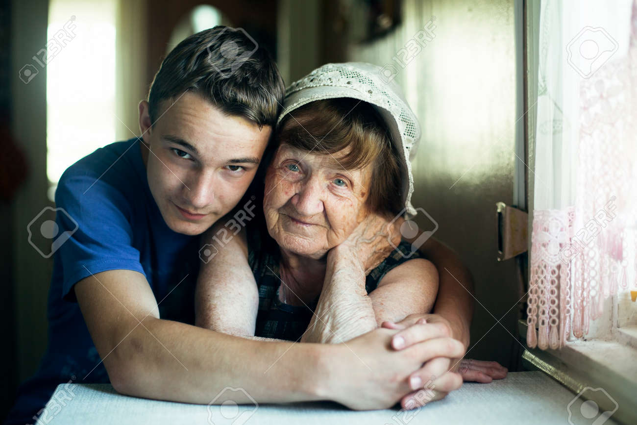 An old woman and her grandson portrait together in an embrace. - 167194226