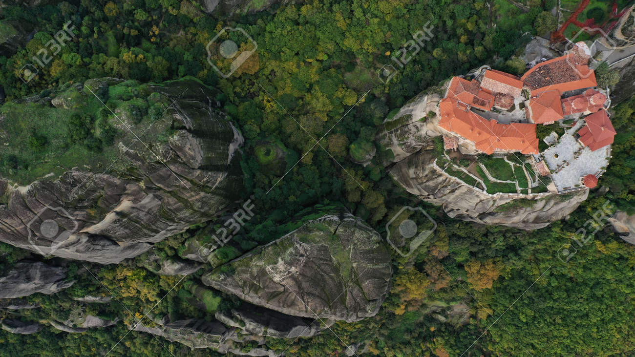 Aerial view of historical orthodox monasteries on the top of meteors cliffs, Kalampaka Kalabaka Kalambaka, Greece. Beautiful mountainous landscape with rocky cliffs. - 140592682