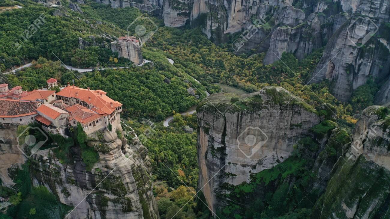 Aerial view of historical orthodox monasteries on the top of meteors cliffs, Kalampaka Kalabaka Kalambaka, Greece. Beautiful mountainous landscape with rocky cliffs. - 140592710