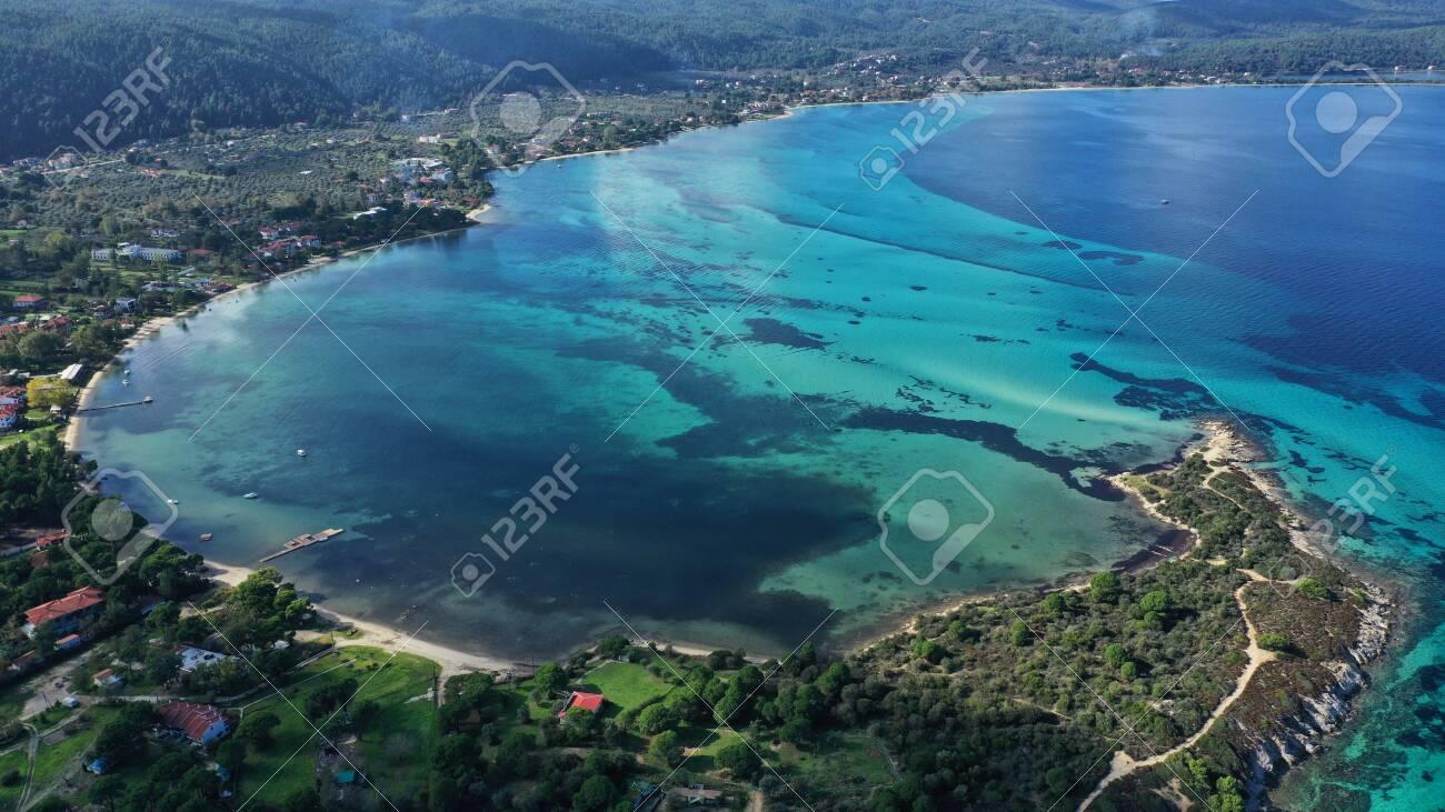Aerial view of Halkidiki landscape, Vourvourou sandy beach, lagoon with rocks, Kavourotripes beach, Sithonia peninsula. Greece. - 140592812