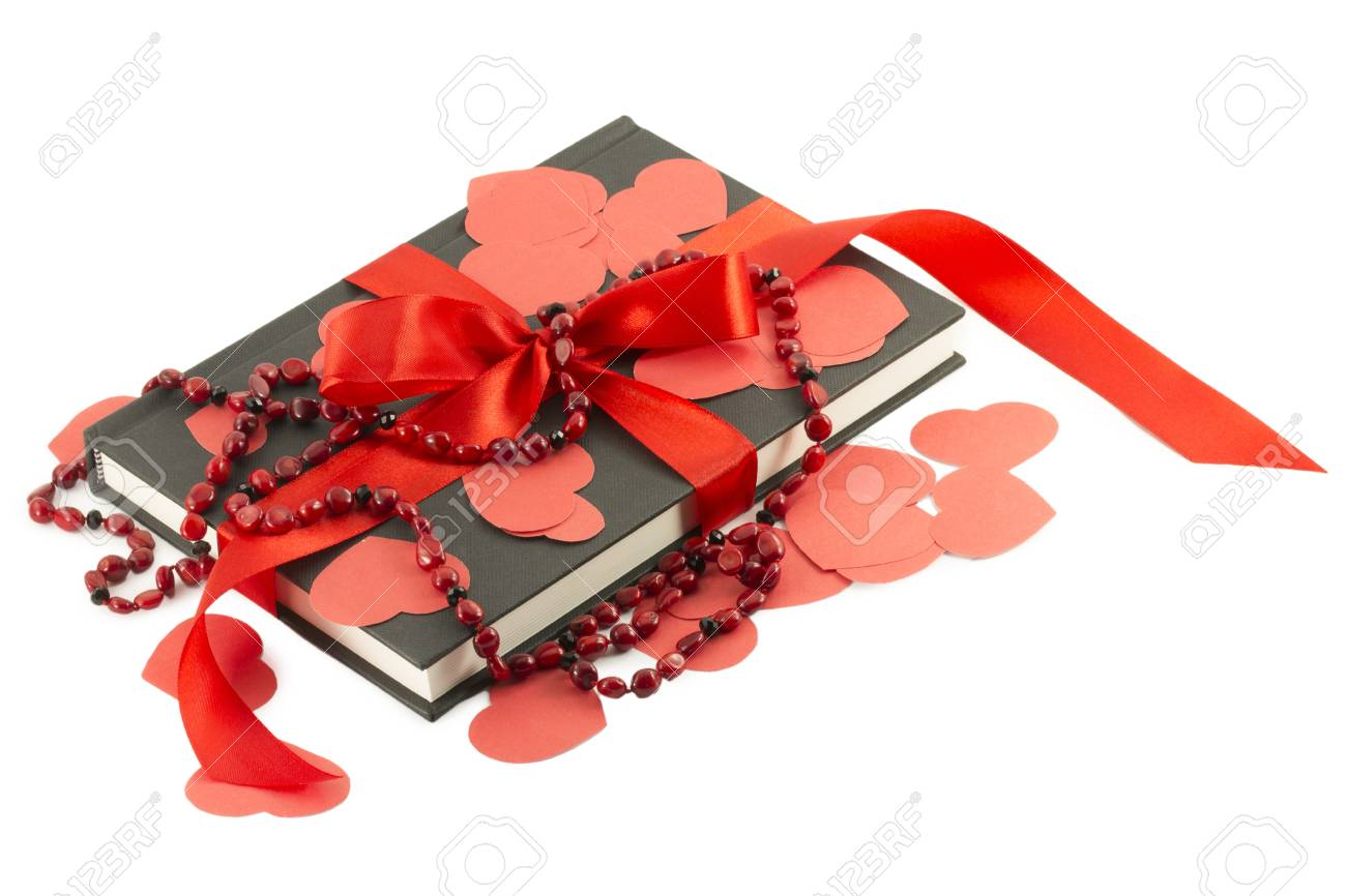 red heart and the book on a white background Stock Photo - 17408355