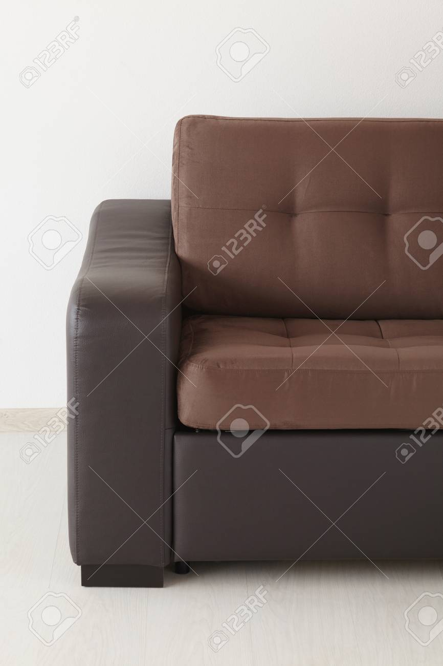 Phenomenal Brown Leather Sofa Isolated Against The Wall Gmtry Best Dining Table And Chair Ideas Images Gmtryco