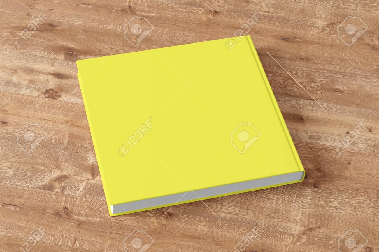 木製の背景の空白のイエロー ブック カバー。 3 D のレンダリング の ...