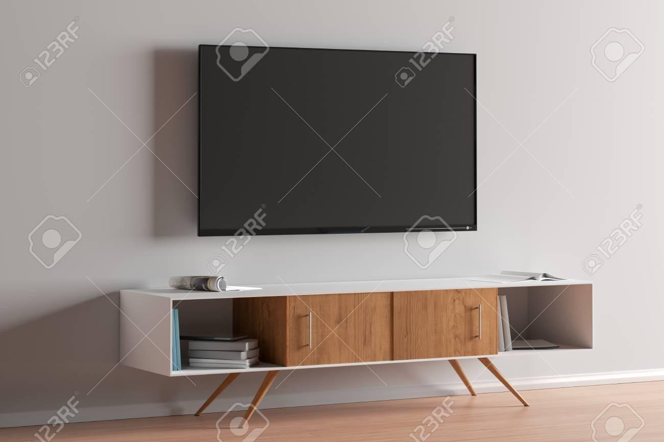 TV screen on the white wall in modern living room. 3d illustration - 122123060