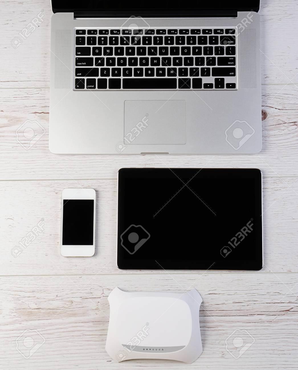 Wifi router modem connect laptop tablet and smartphone on wood stock stock photo wifi router modem connect laptop tablet and smartphone on wood keyboard keysfo Image collections