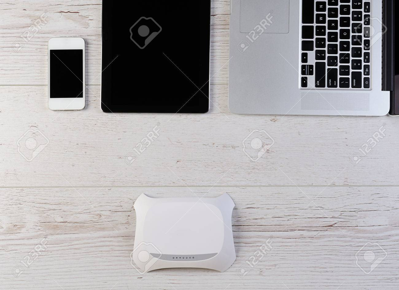 Wifi internet router modem connect laptop tablet and smartphone stock photo wifi internet router modem connect laptop tablet and smartphone on wood keyboard keysfo Image collections