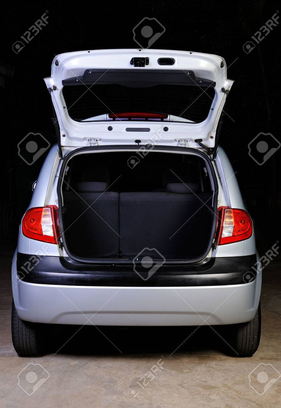 open empty trunk of hatchback isolated on black - 55298343
