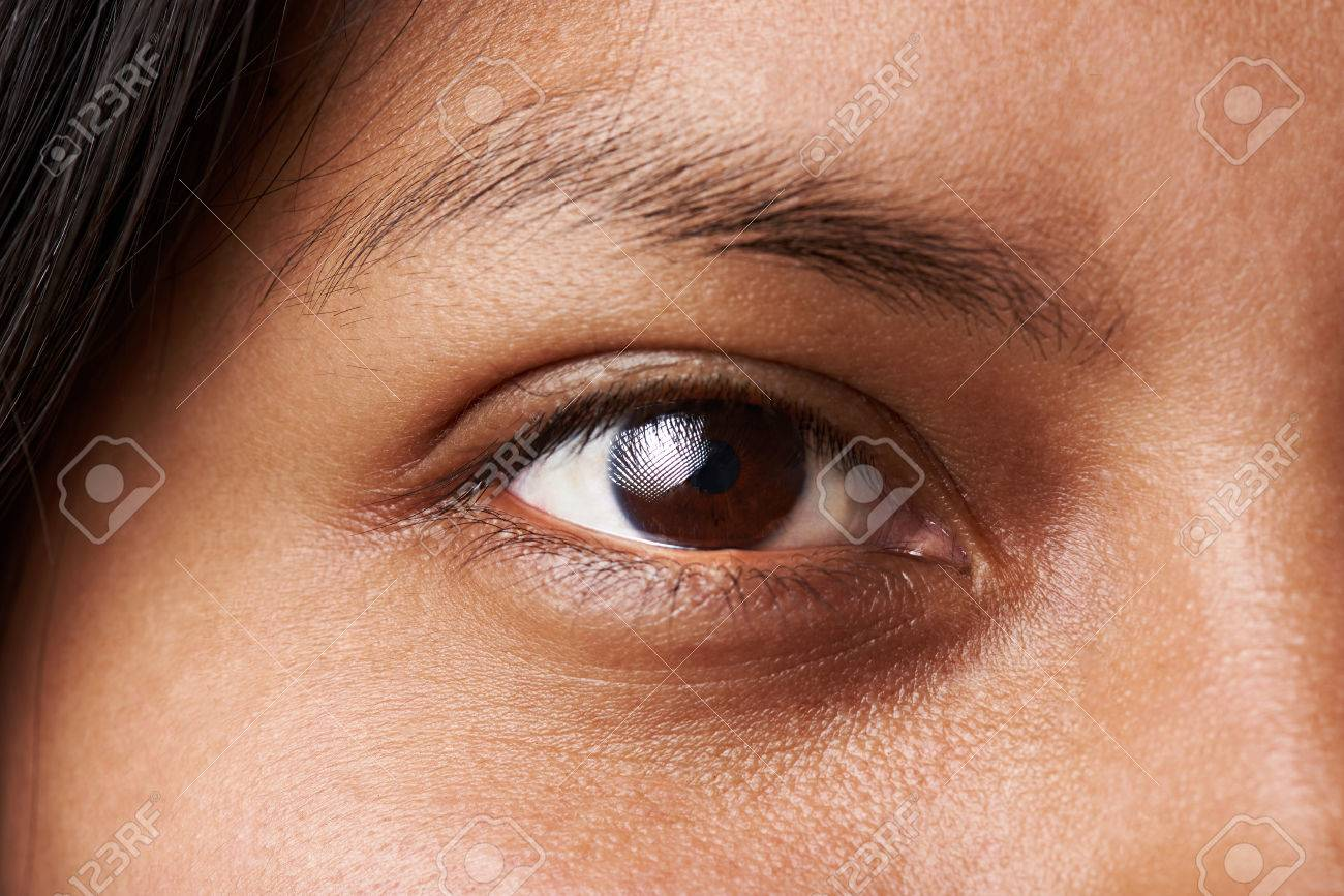 Macro of woman dark brown eye without cosmetic or makeup - 69680594