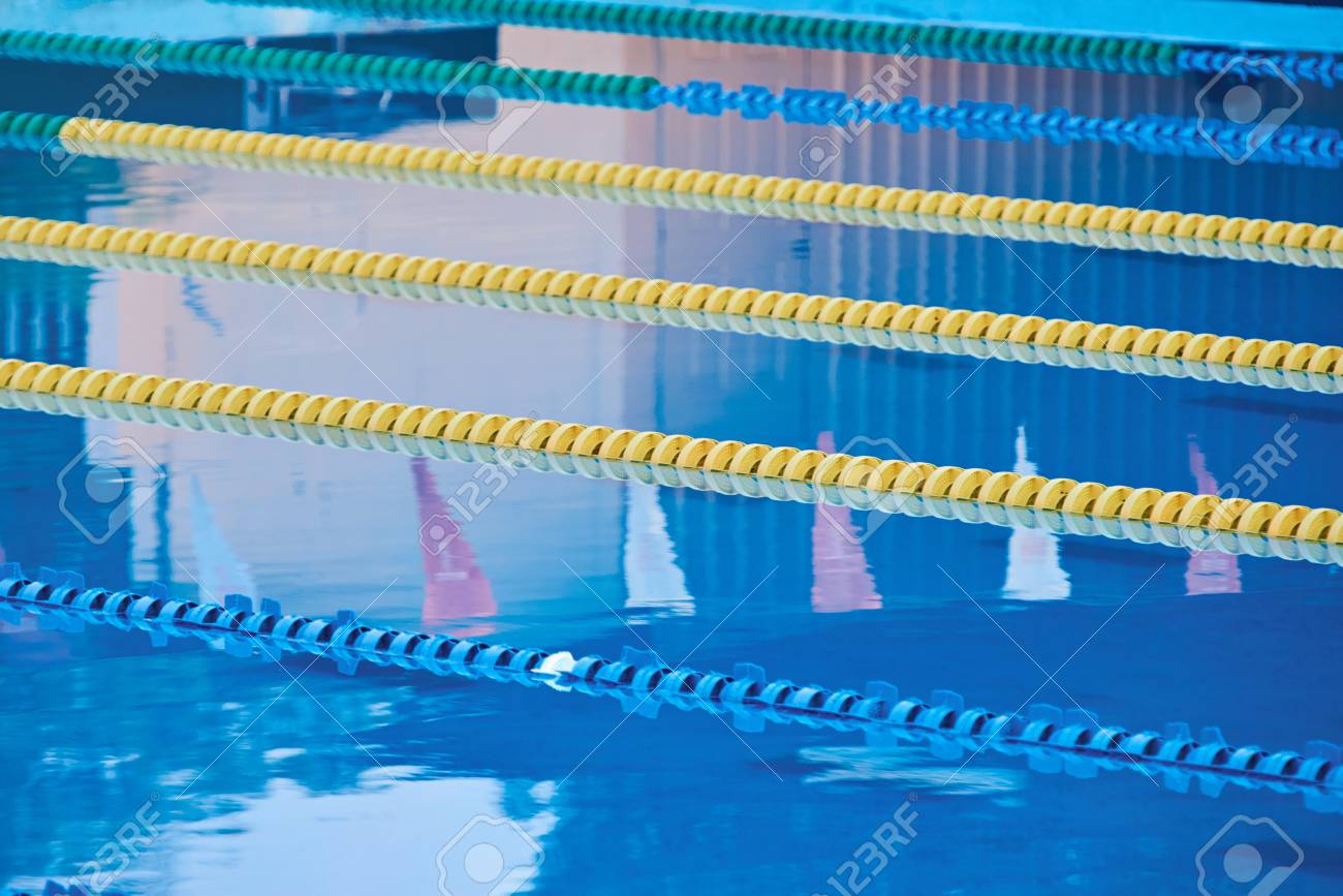 Lanes in blue water pool. Clean clear still water in pool