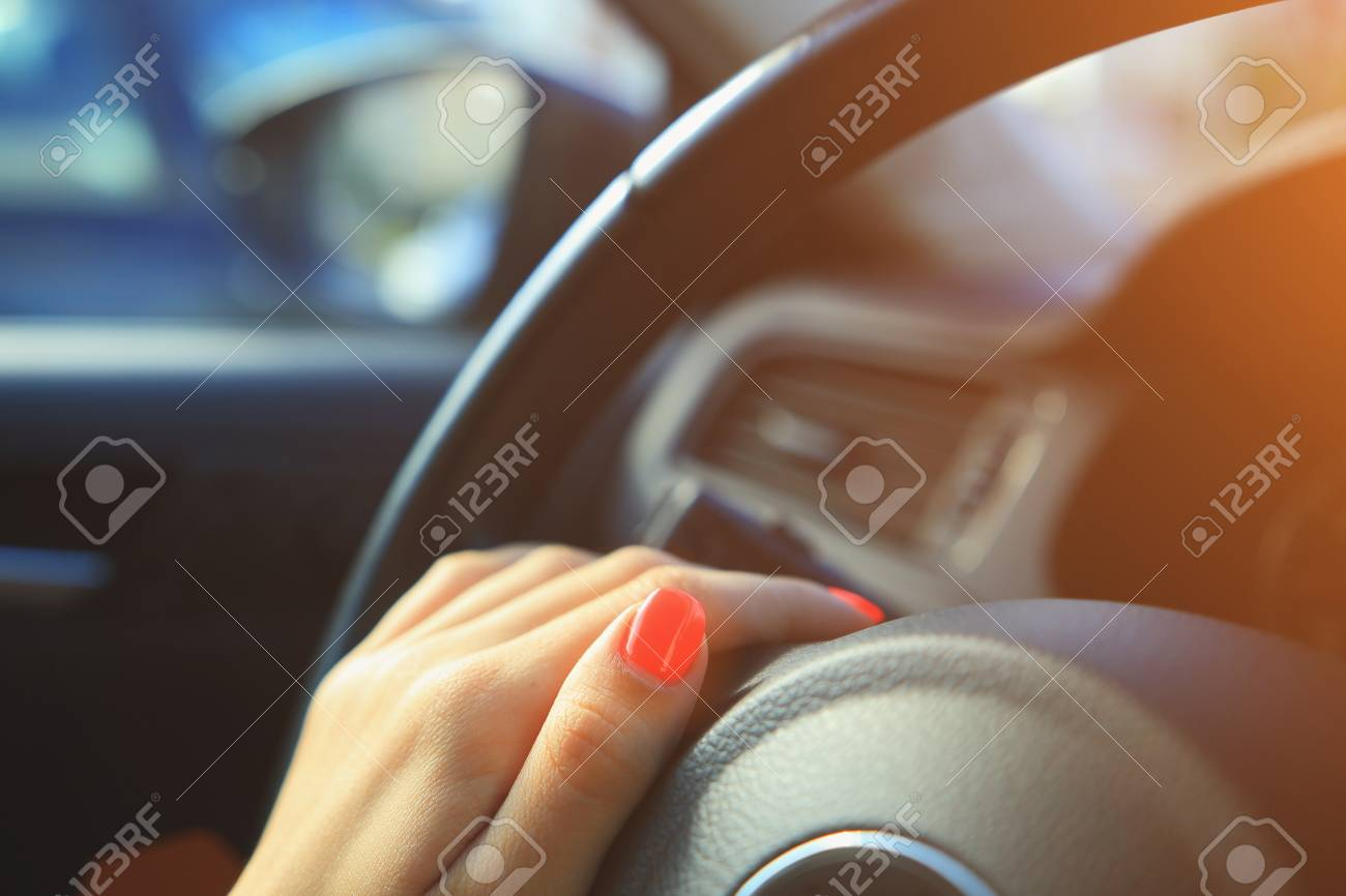Woman Driving Background Fingers With Pink Vivid Nails On Steering Stock Photo Picture And Royalty Free Image Image 79633106