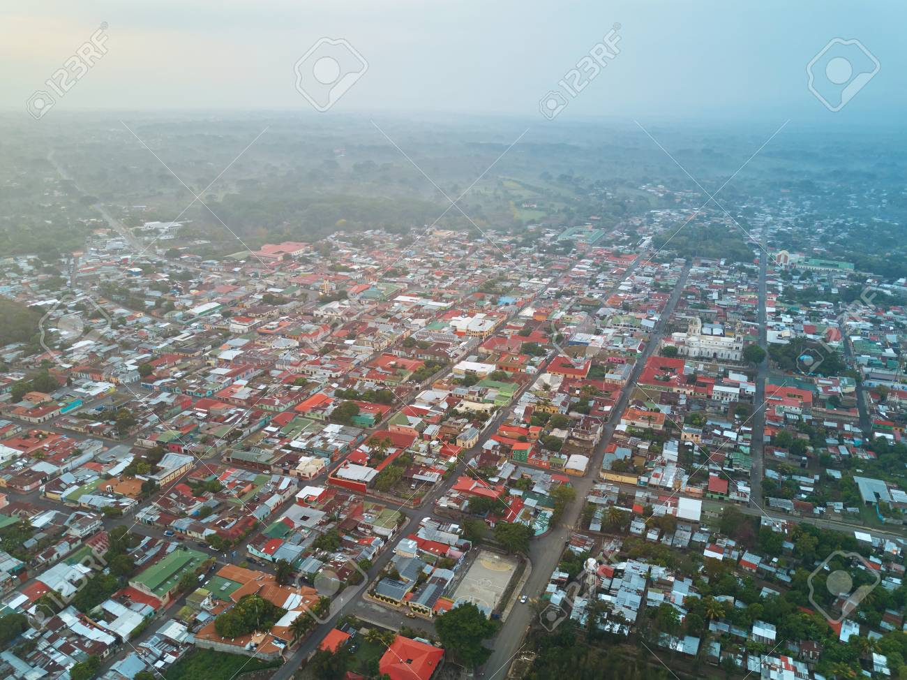Small City Blocks Aerial View In Morning Sunrise Light Time Drone On Little Town