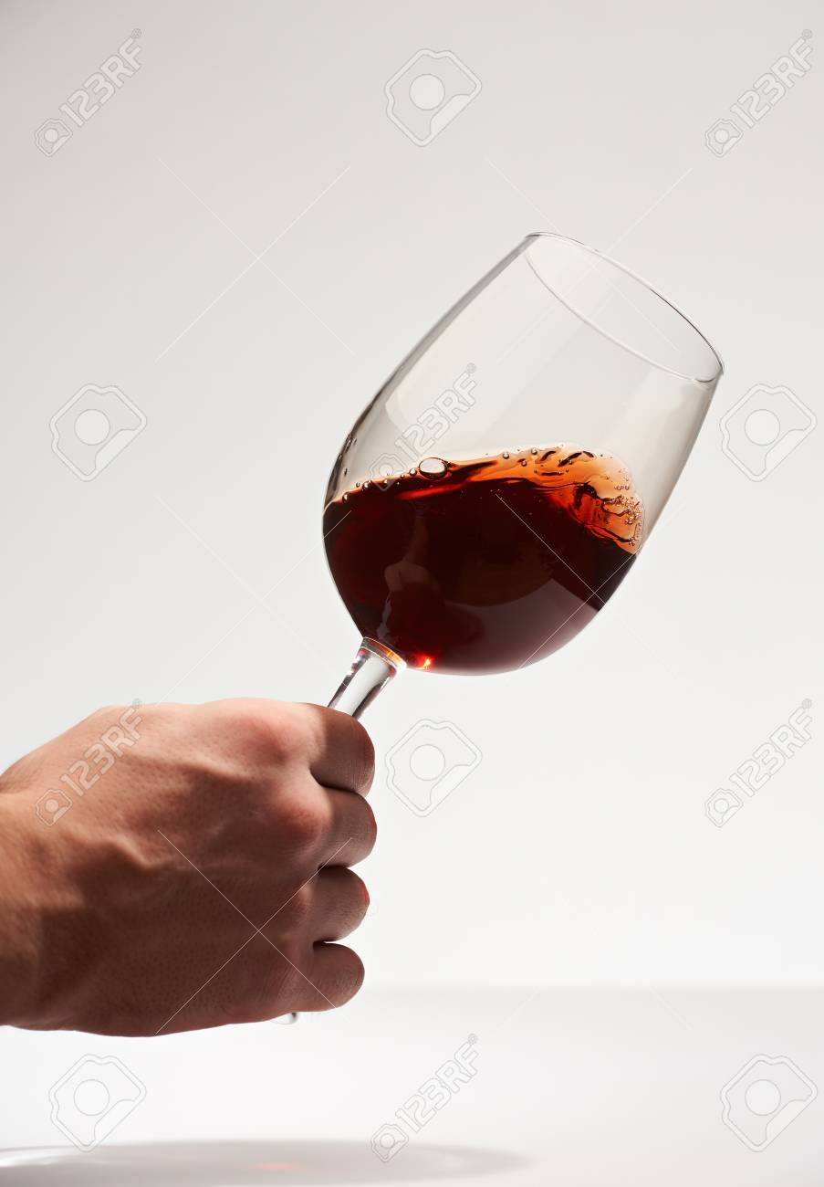 Test red wine isolated on white background hand hold wine glass stock photo test red wine isolated on white background hand hold wine glass winery background ccuart Gallery