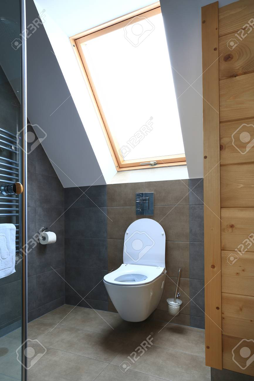 . Clean modern toilet with window  Interior of new bathroom