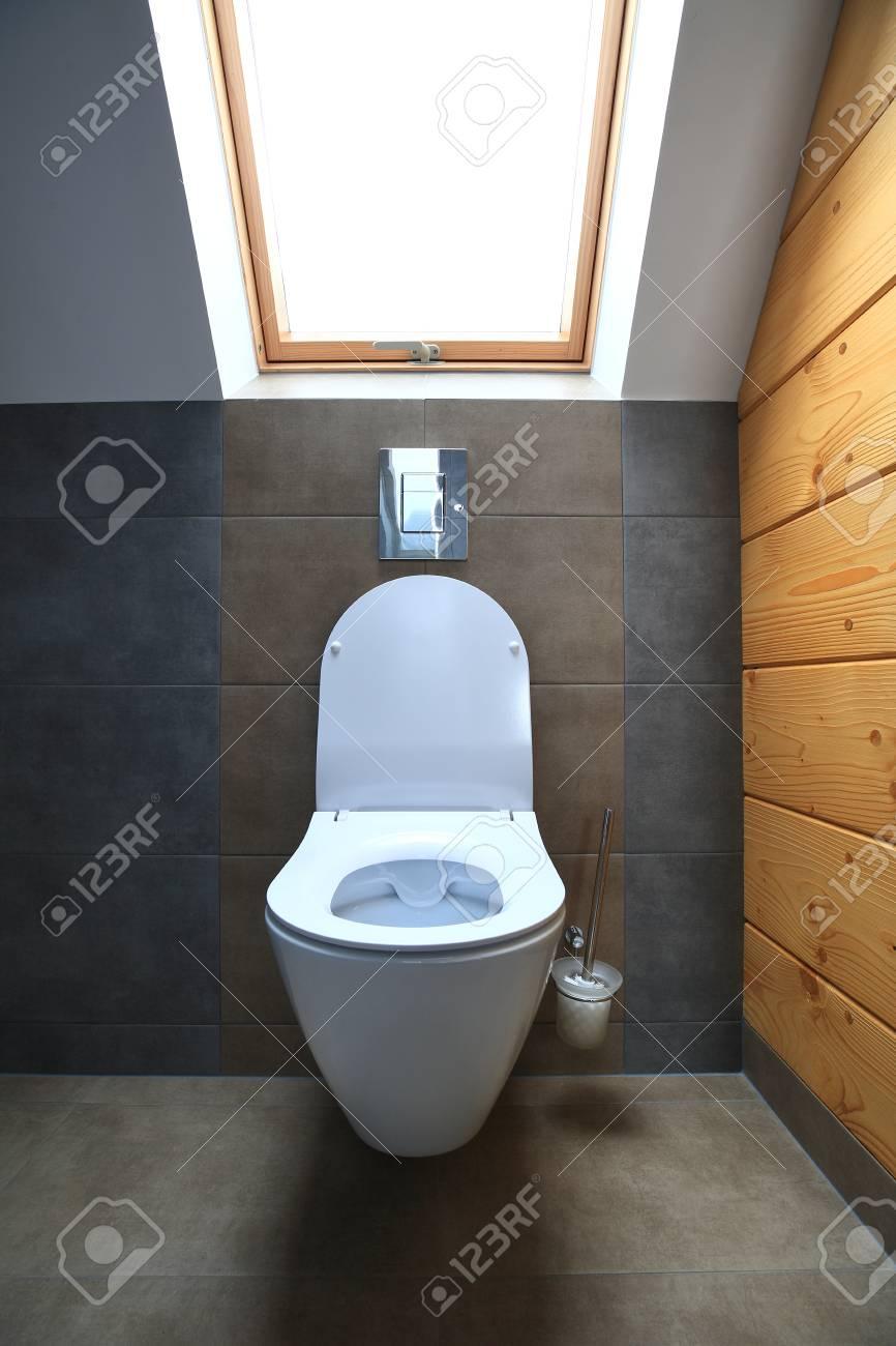 . Shiny white modern toilet  Toilet with window  Toilet illuminated