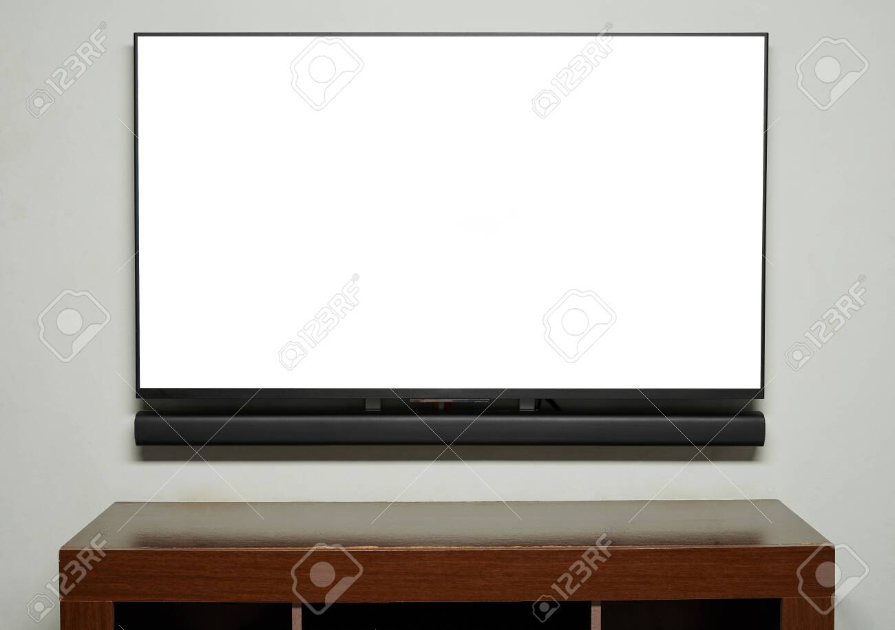 Big Tv Screen Hang On Wall With Empty Wooden Table Stock Photo Picture And Royalty Free Image Image 146804085