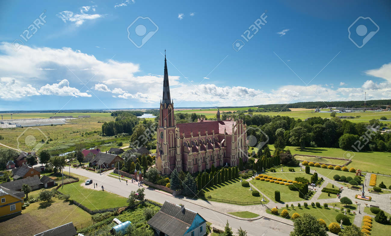 Red catholic church on blue sky background aerial view - 171542745
