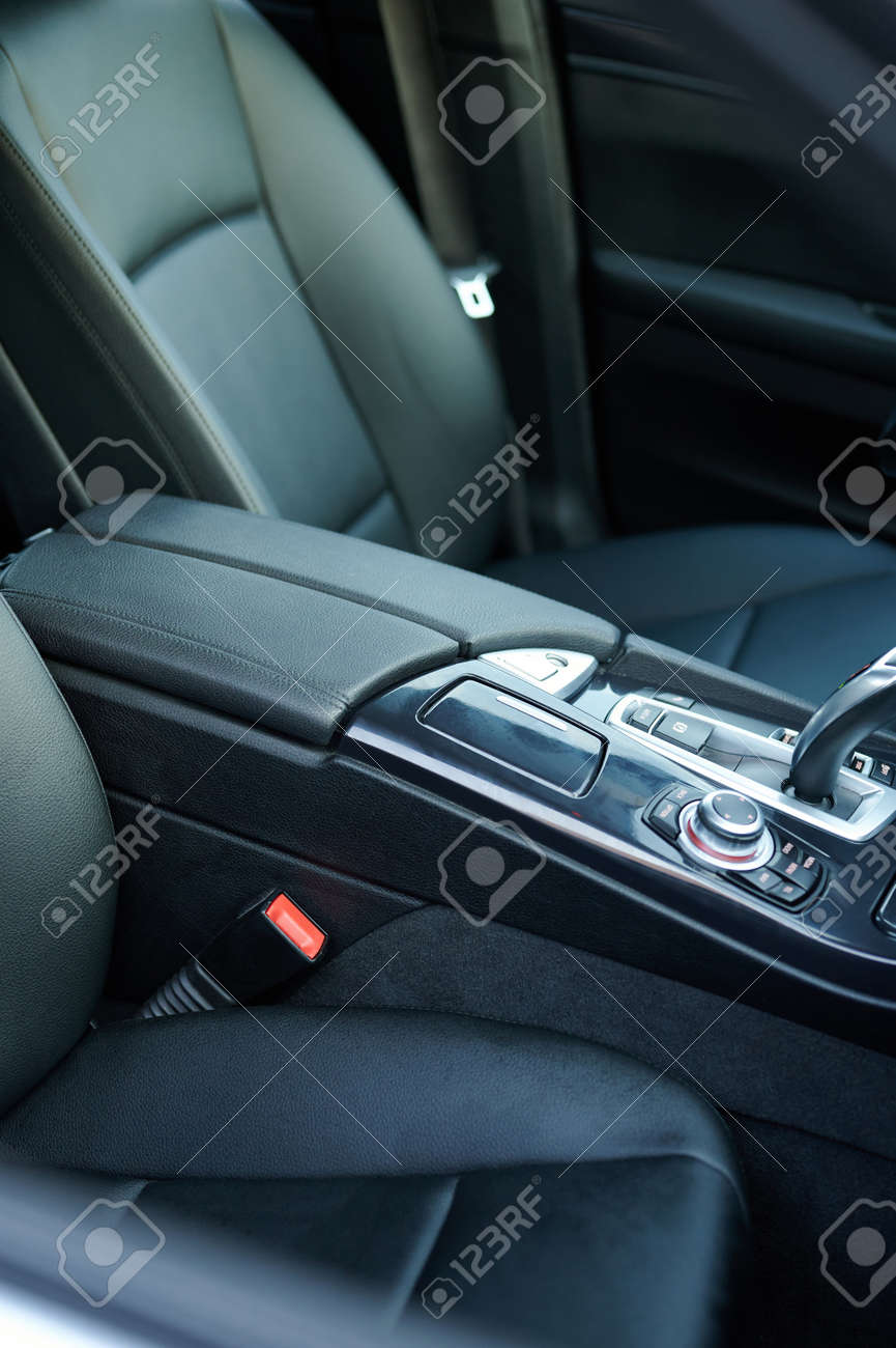Leather black armrest in car console with gear stick close up view - 172044755