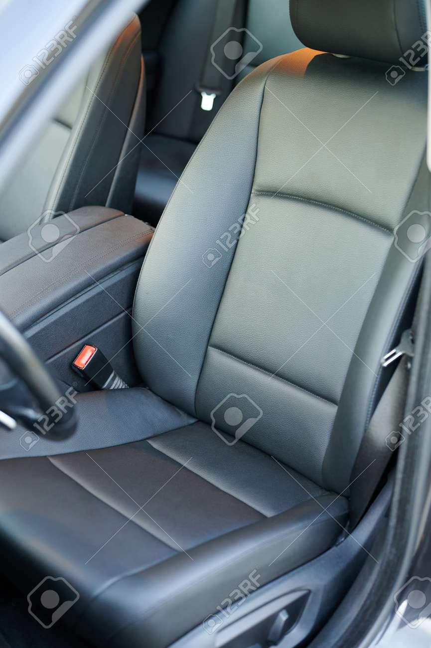 Clean dark black leather driver car seat with handrest - 171863521