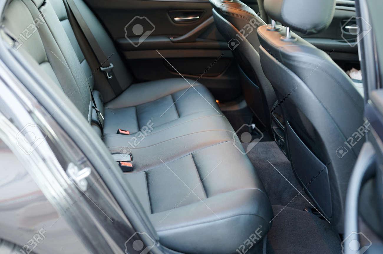 Black leather new car back seat in modern sedan - 172044758
