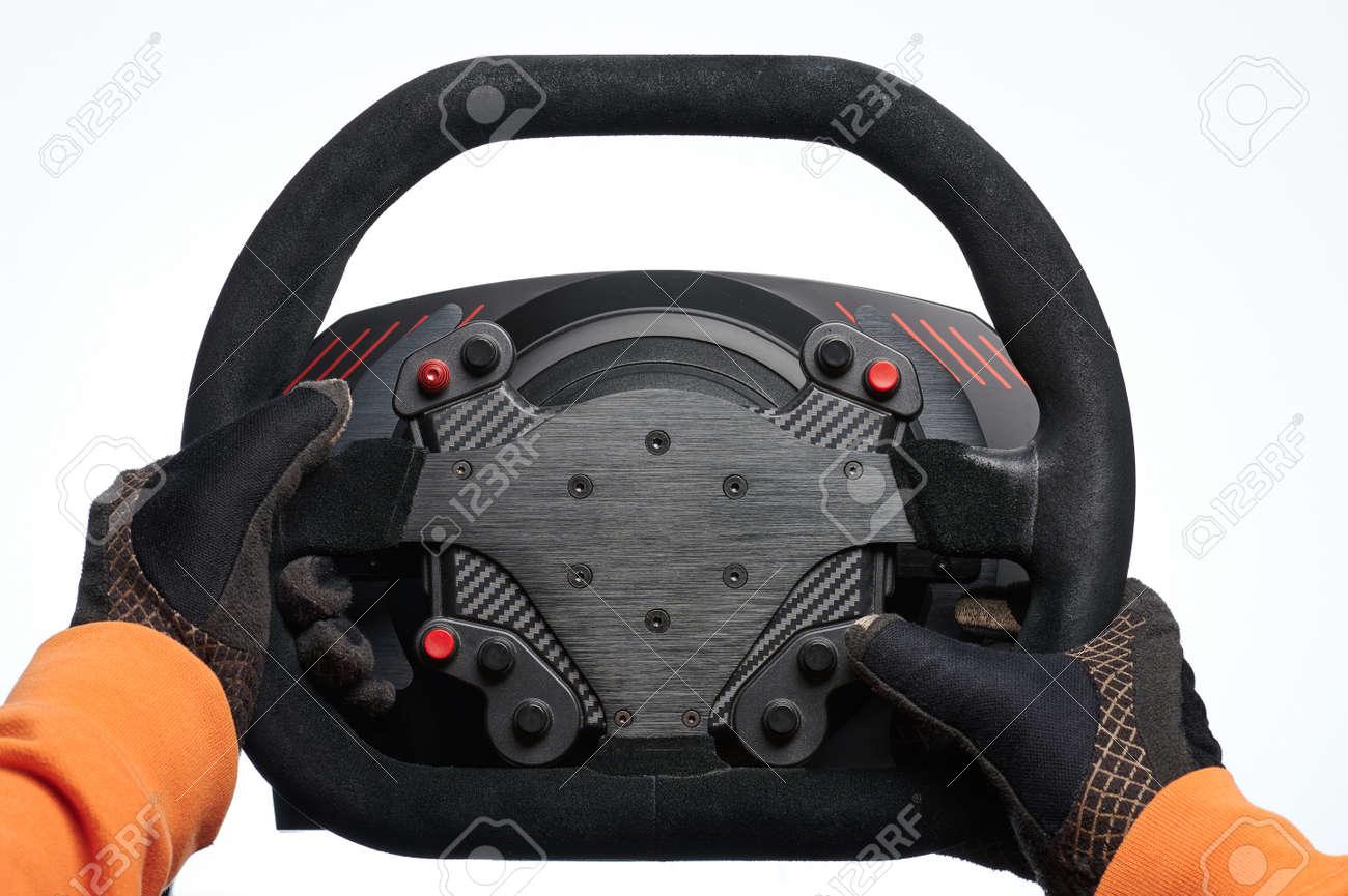 Racer hands in gloves hold black steering wheel isolated on white studio background - 171896946