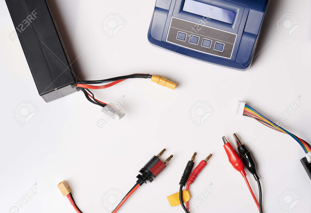 Cables for battery connection and charger isolated on studio background - 171946323