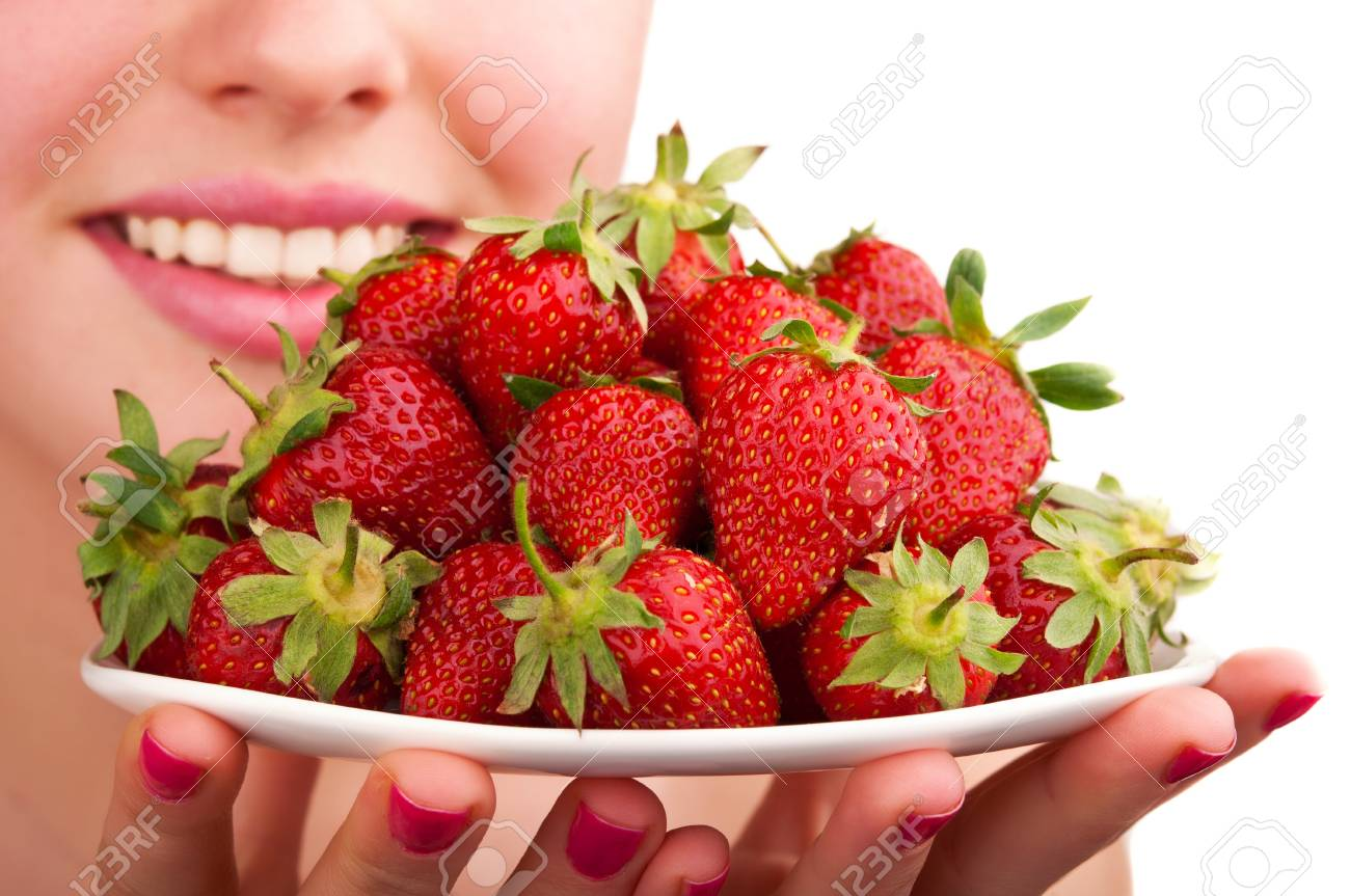 woman holding strawberry isolated on a white background Stock Photo - 14062223