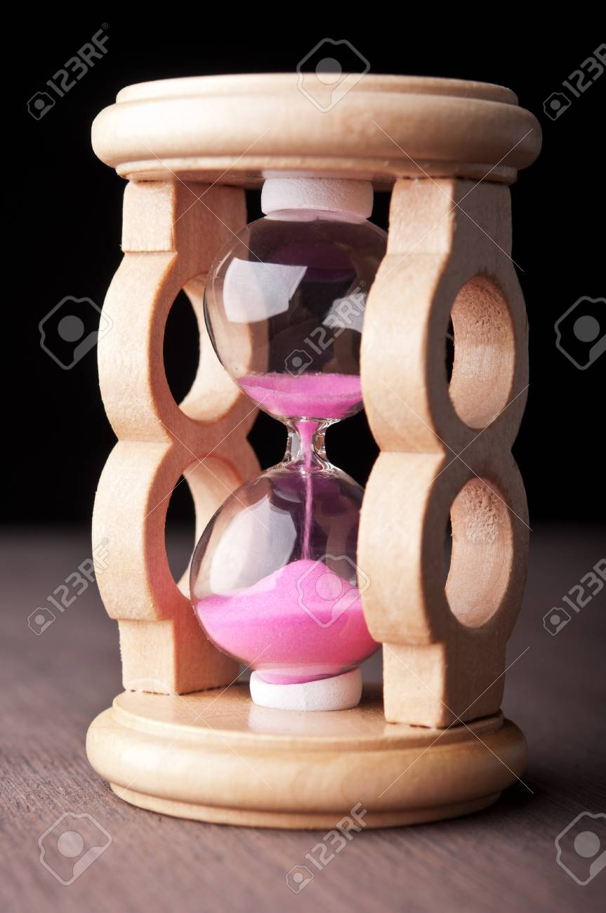 hourglass clock on wooden table Stock Photo - 17706786