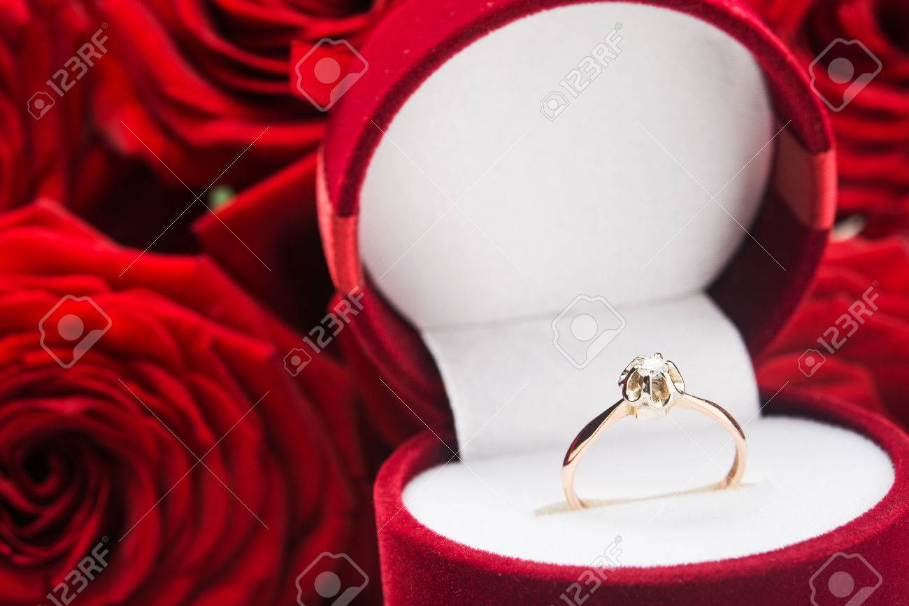 close up of golden ring gift on valentine day stock photo