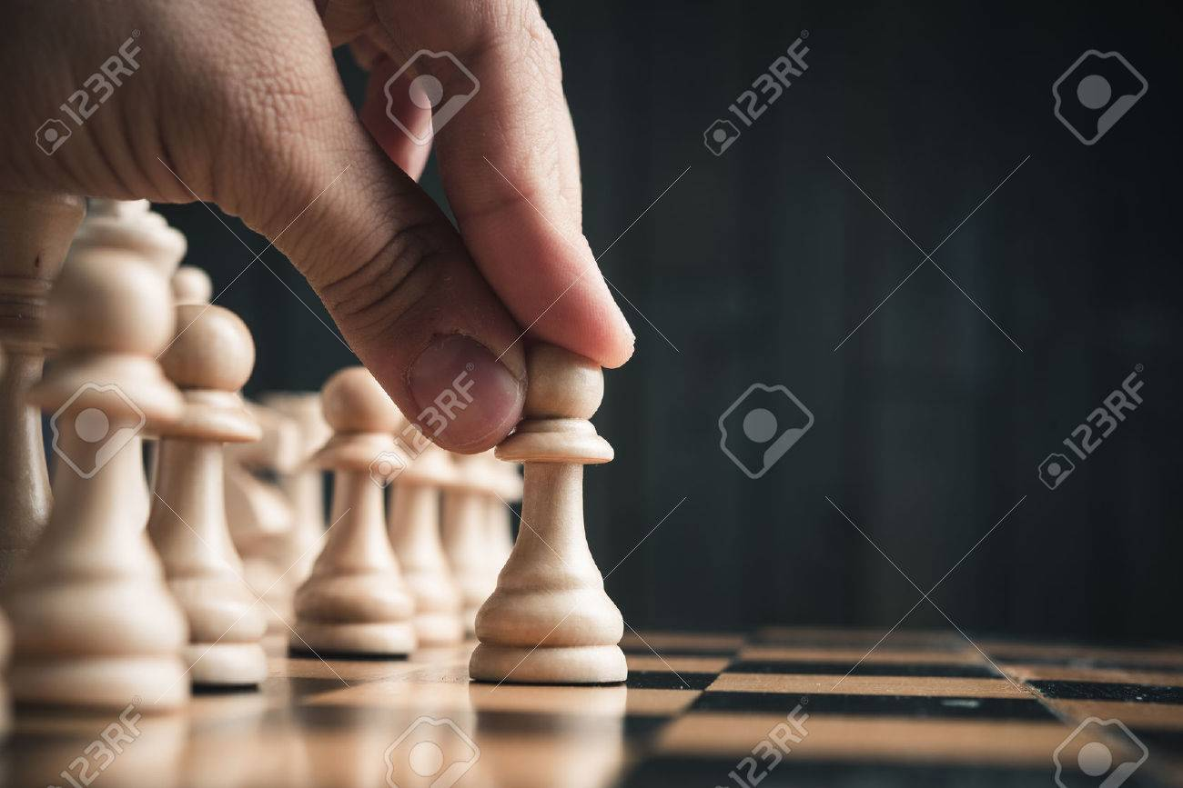 Chess pieces on the board. Black wood background behind. - 52680858