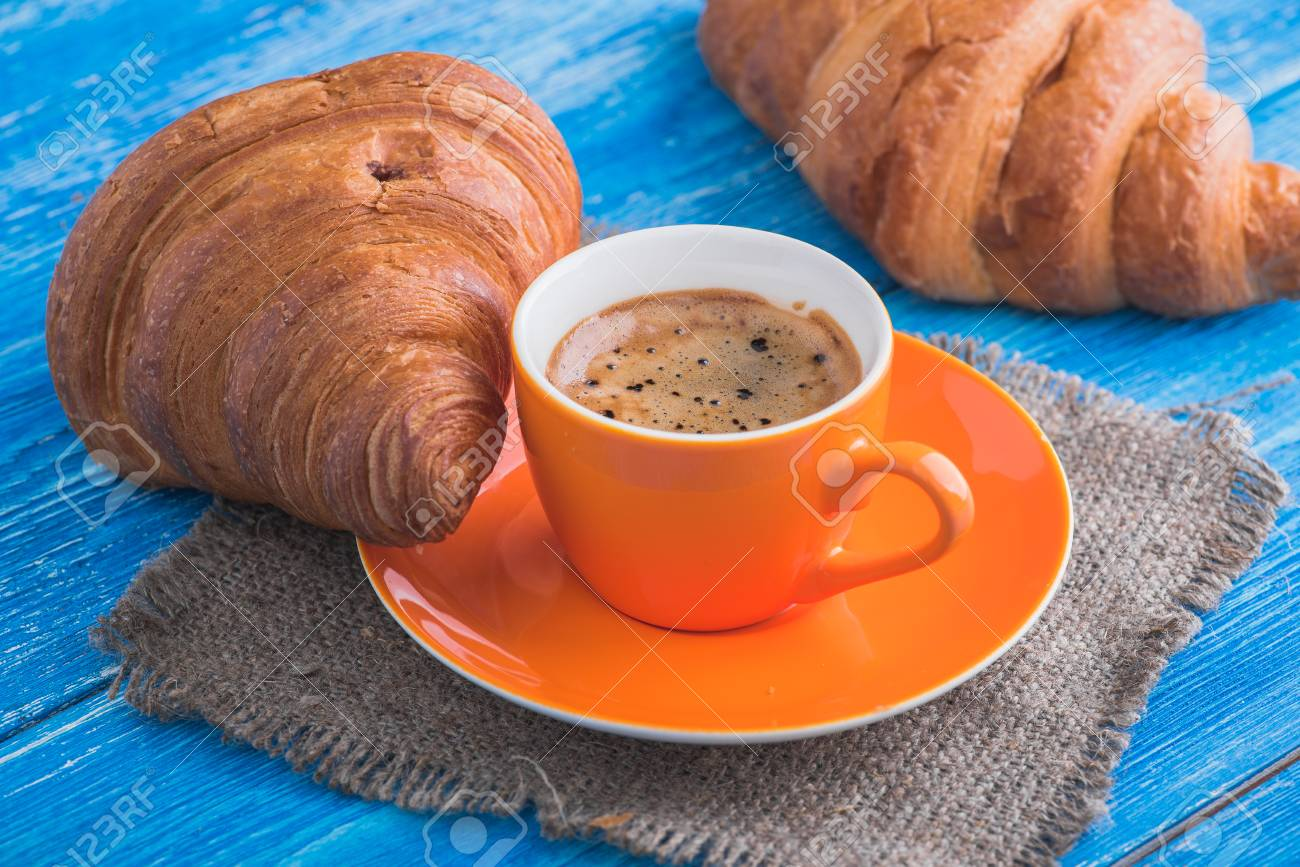 Tasty Cup Of Coffee With Croissant On Wooden Table Delicious Stock Photo Picture And Royalty Free Image Image 80117167