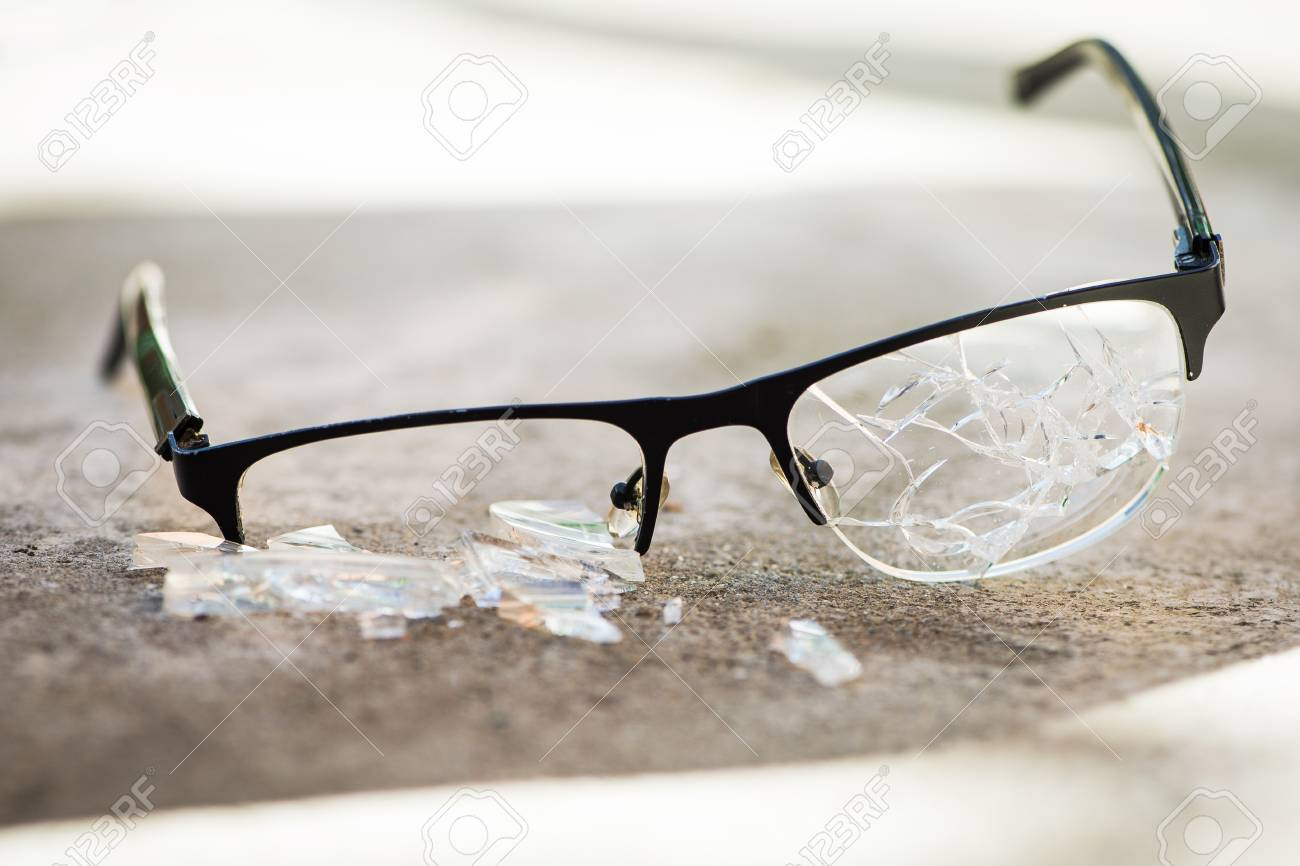 Broken Glasses On The Asphalt. Street Accident Concept. Poor.. Stock ...