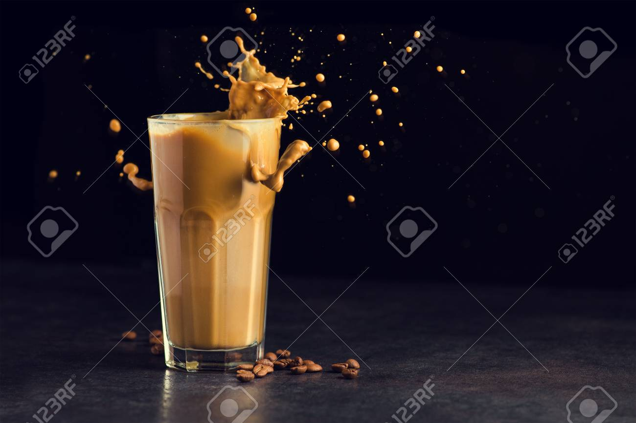 Iced latte coffee glass with splash on a black background - 96747237