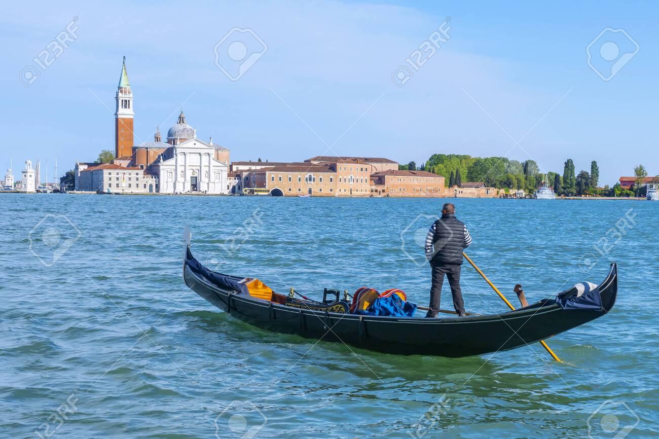 Gondola on the background of San Giorgio Maggiore in Venice, Italy - 139560373