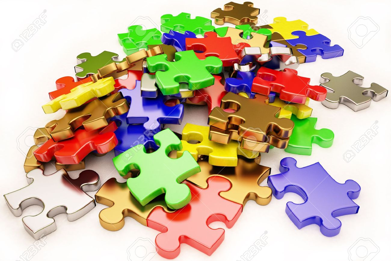 the background unsolved bunch of jigsaw puzzles pieces stock photo