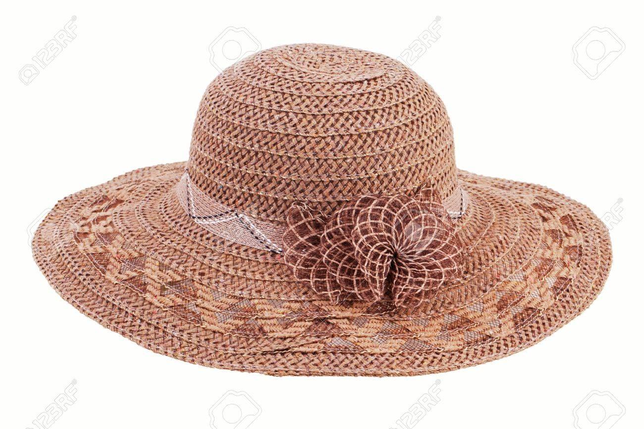 770504d87fed0 Foto de archivo - Sombrero de mimbre marrón sobre un fondo blanco