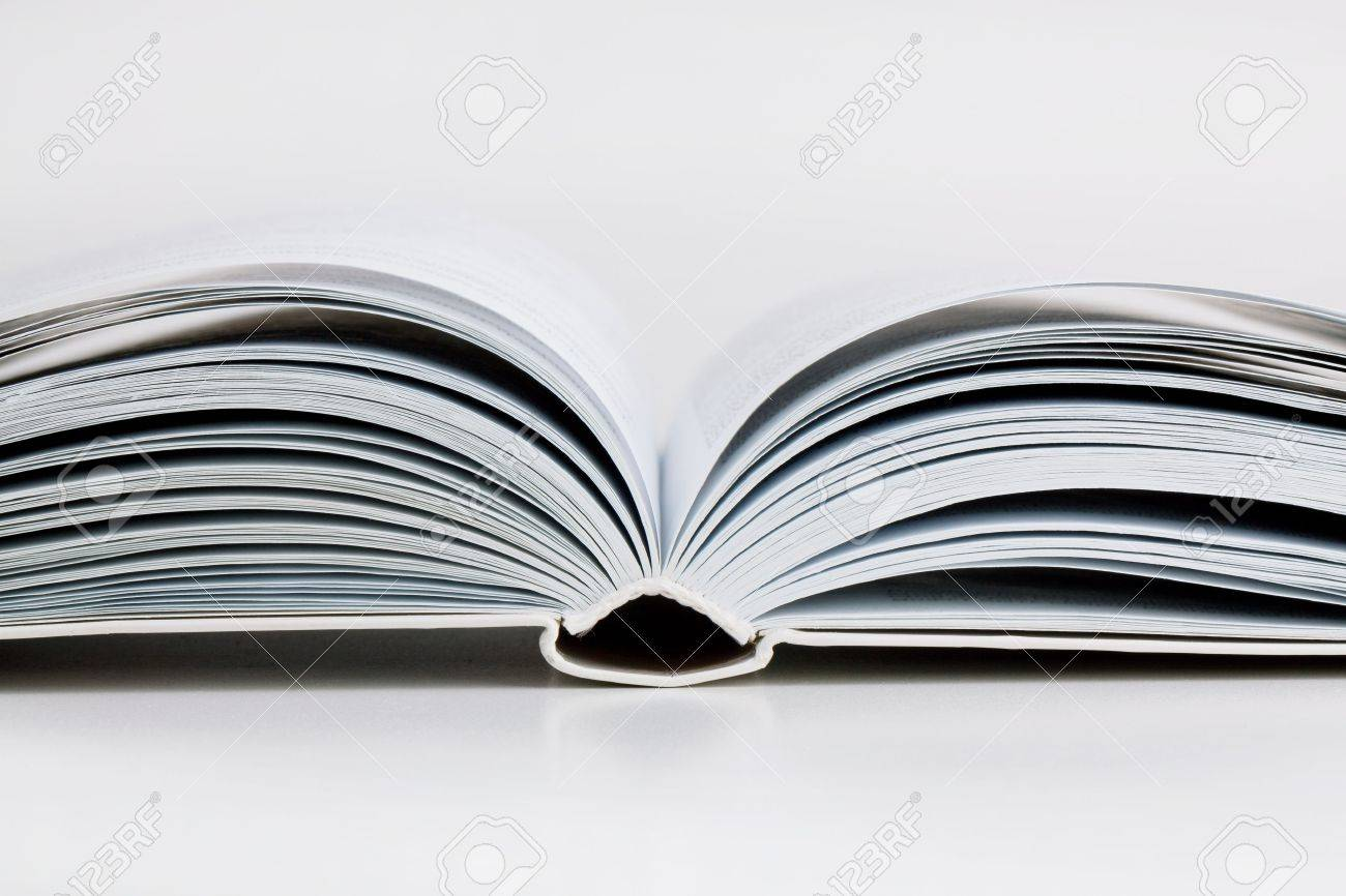 pages open a thick book on white background stock photo picture and
