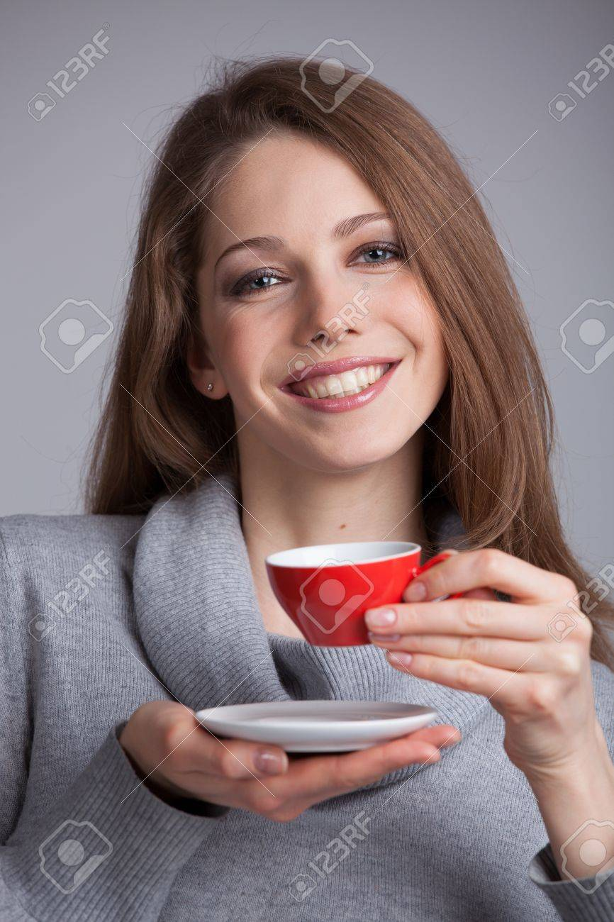 Cute girl in sweater holding a cup of coffee Stock Photo - 17018976