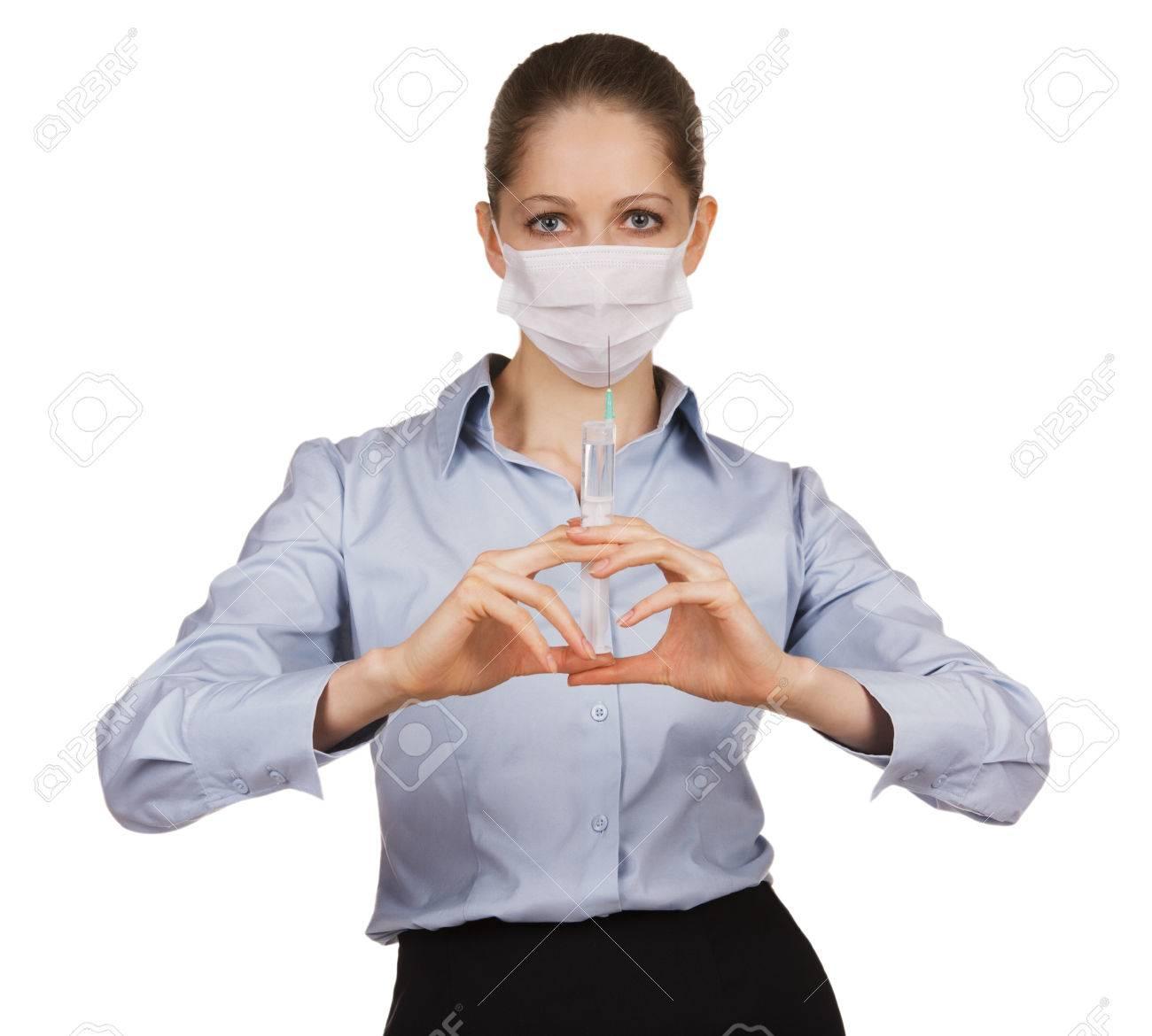 Girl in a medical mask holding syringe Stock Photo - 25088702