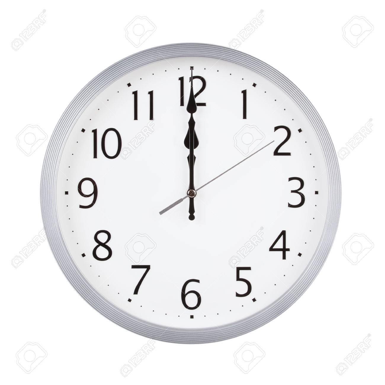大きな丸い時計のダイヤルの正午...