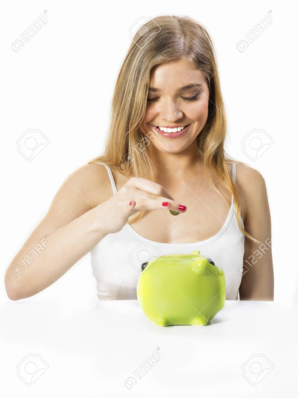 Pretty girl putting  coins in moneybox Stock Photo - 20310797