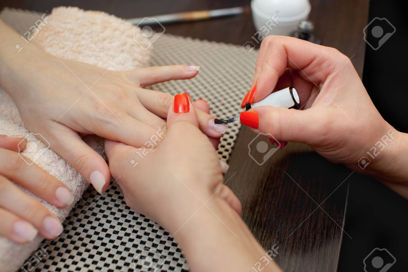 The Master Of The Manicure Paints Nails With Nail Polish During ...