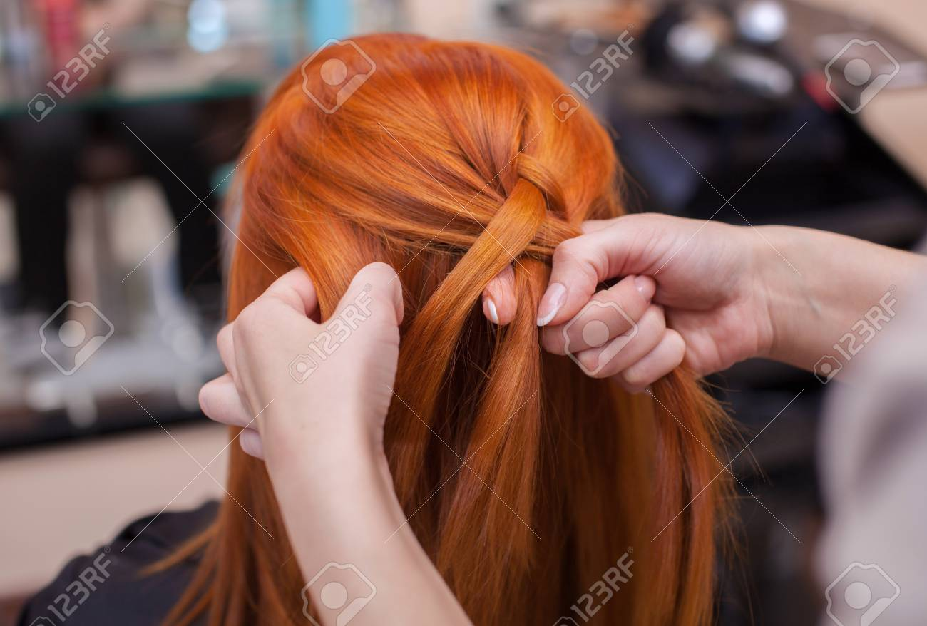 Beautiful Red Haired Girl Hairdresser Weave A French Braid Close Up
