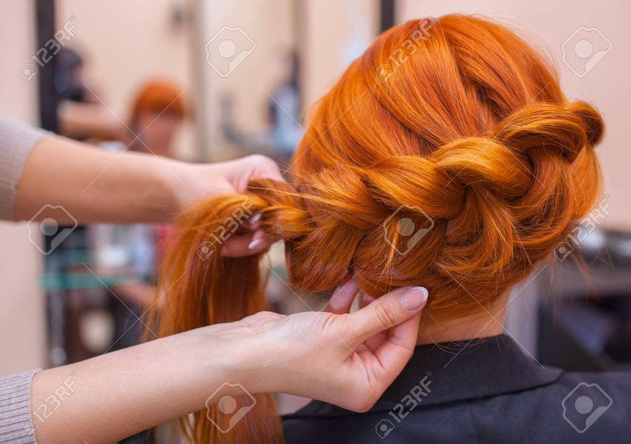 Beautiful Girl Hairdresser Weaves A Braid In A Beauty Salon