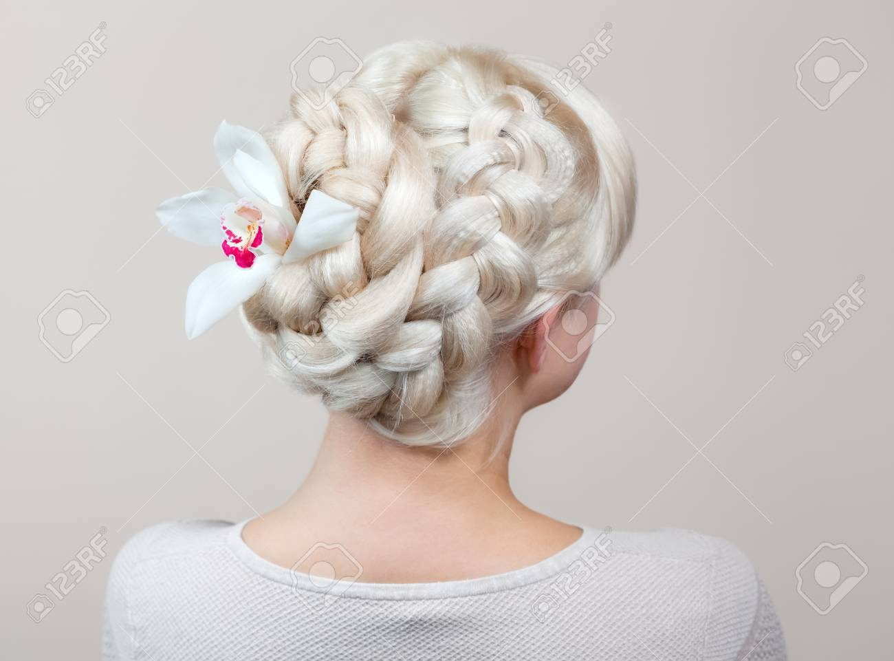 Beautiful Girl With Blonde Hair Hairdresser Weaves A Braid Stock