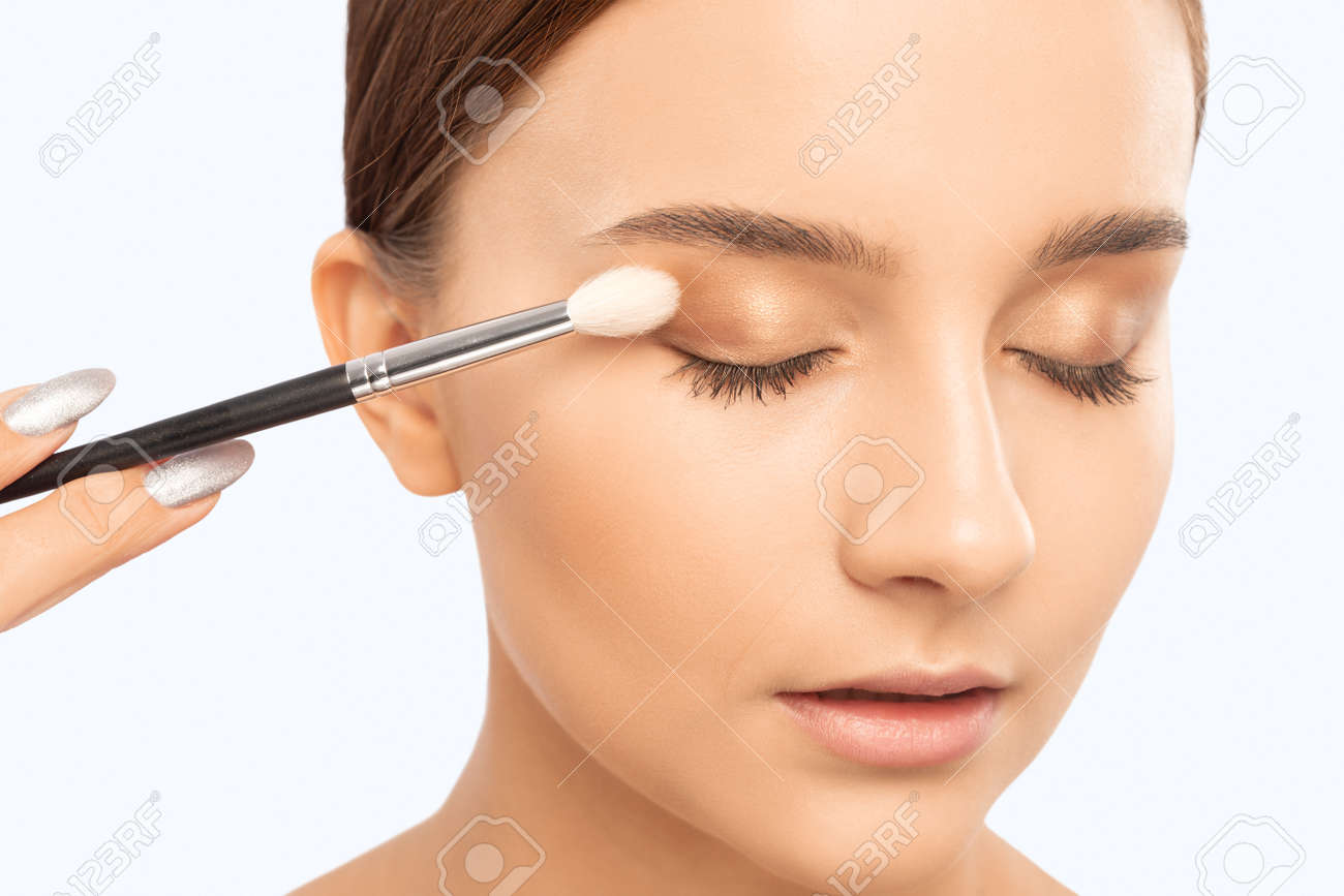 Portrait of a beautiful teenage girl with beautiful makeup, extended long eyelashes and healthy clean skin. Makeup and cosmetology concept. - 165854424