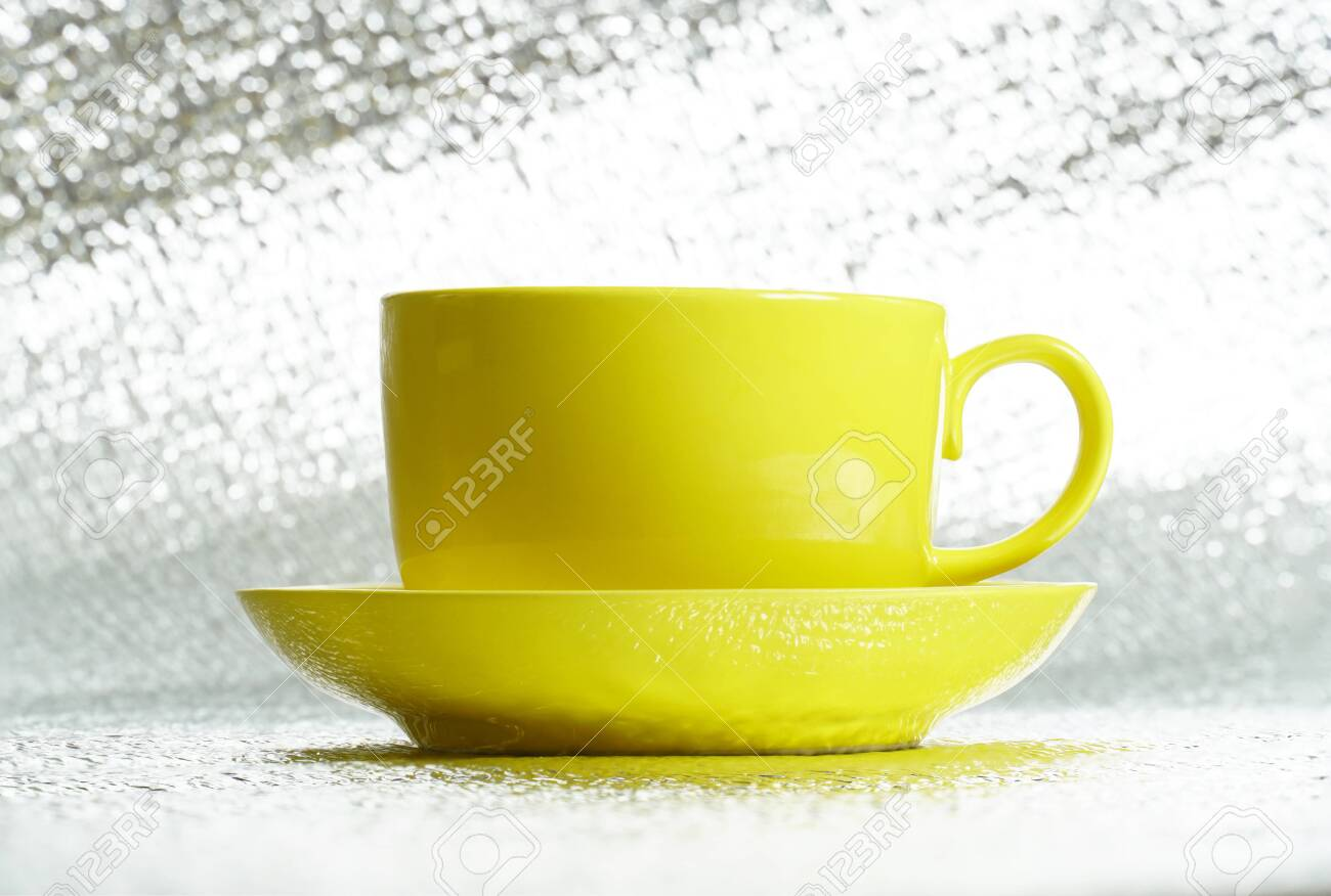 Yellow Ceramic Glossy Cup In Saucer On Silver Background Template Stock Photo Picture And Royalty Free Image Image 143645033