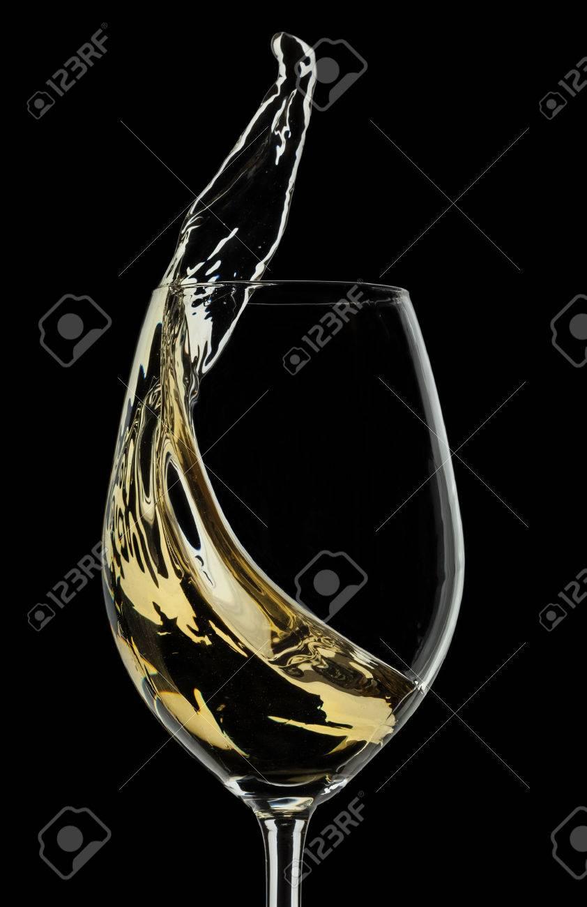 White wine splash on black background - 26280118