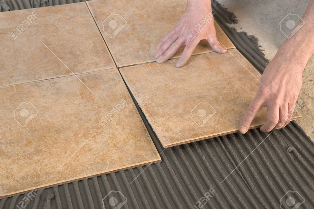 Laying floor tiles stock photo picture and royalty free image laying floor tiles stock photo 26540263 dailygadgetfo Image collections