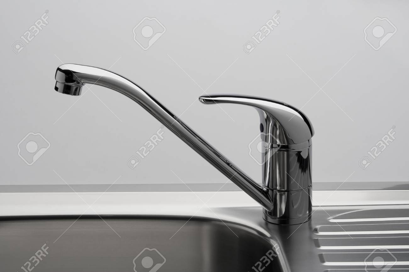 Water tap and sink in a modern kitchen - 27848472