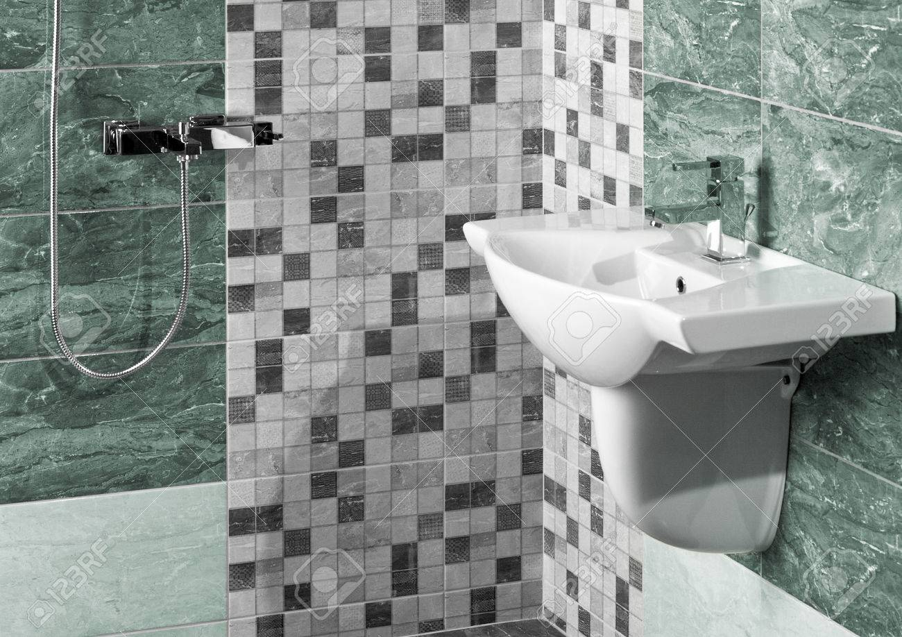 detail of a modern bathroom interior with white sink and marble tiles - 42118595